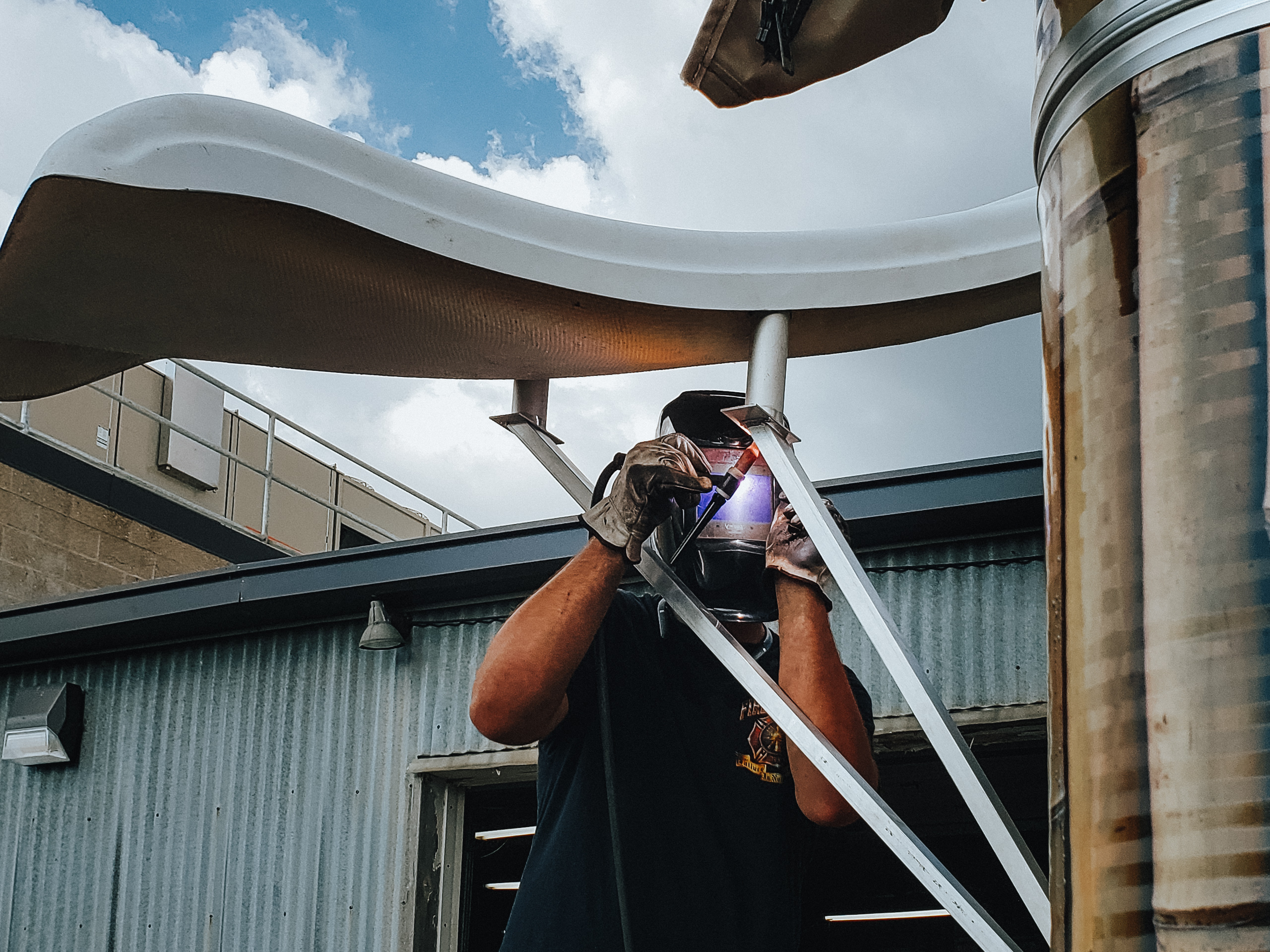 Welding aluminum outside the shop to complete custom water slide project